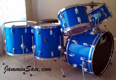 Photo of Andy Graham's Pearl Fiberglass drums with JS Hi Gloss Tropical Blue drum wrap (73)