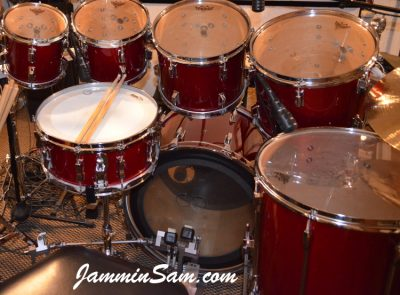 Photo of Jim Tomaselli's Pearl Maple drums with JS Hi Gloss Deep Red drum wrap (51)