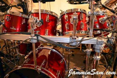 Photo of Jim Tomaselli's Pearl Maple drums with JS Hi Gloss Deep Red drum wrap (64)