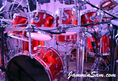 Photo of Jim Tomaselli's Pearl Maple drums with JS Hi Gloss Deep Red drum wrap (73)