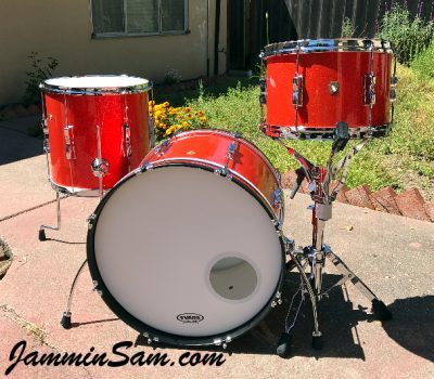 Photo of Mark Melvin's Ludwig drumset with JS Tangerine Sparkle drum wrap (1)