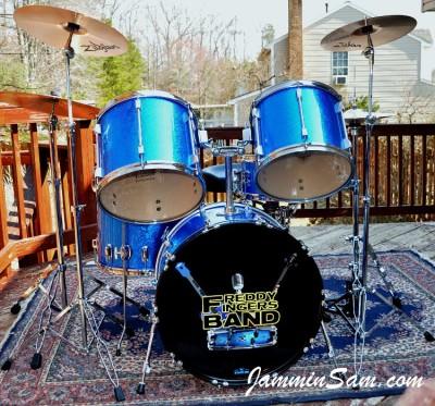 Photo of Zorri Berríos's drum set with JS Blue Sparkle drum wrap (77)