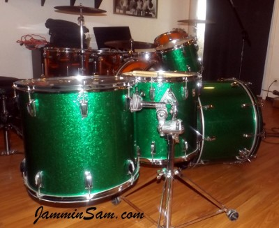 Photo ofKeith McAlexander's Ludwig drum set with JS Sparkle Green drum wrap (53)
