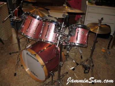 Photo of Dan Kendall's set of Ludwig drums with JS Pink Sparkle drum wrap (88)