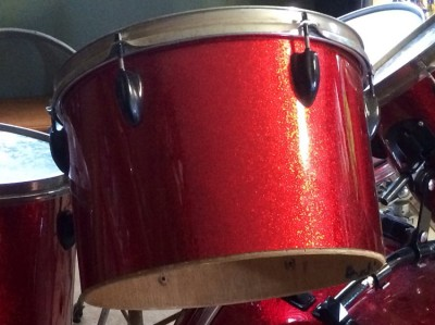 Photo of Derek Rodriguez's drum set with JS Sparkle Red drum wrap (2a)