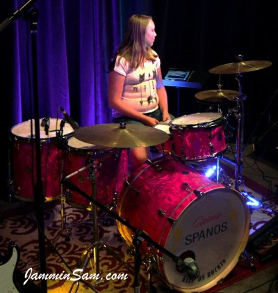 Photo of Cassie Spanos' drums with Neon Pink Satin drum wrap (1)