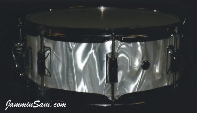 Photo of Shaun Traynor's snare with White Satin Flame drum wrap
