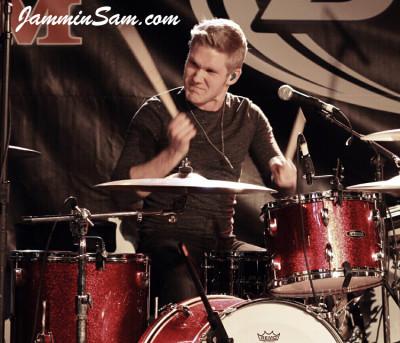 Photo of Josh Daubin's Pearl drum set with Red Vintage Sparkle drum wrap (2)