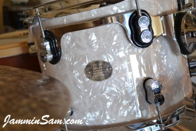 Close-up photo of Spider Ryan's DW drum with Vintage White Pearl drum wrap (6)
